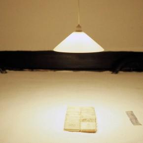 Hospital light shines on hospital soup resting on a floor of salt